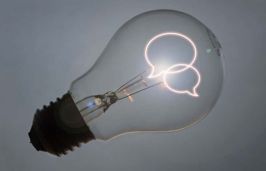 Lightbulb with speech bubbles inside