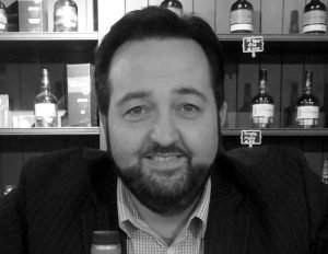 Brand Manager for Walsh Whiskey, Woody Kane