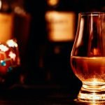 Whisky glass in festive scene