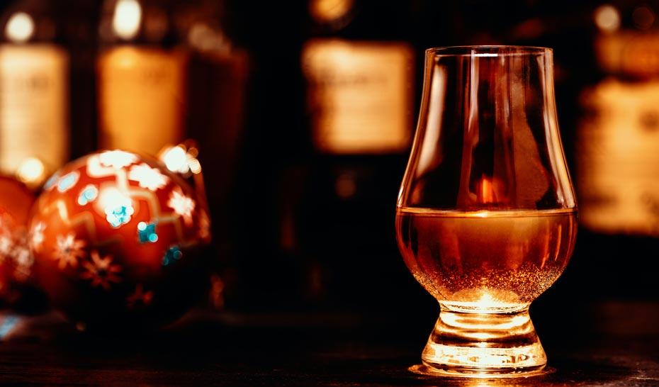 Whisky glass in festive scene