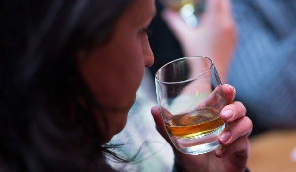 A woman nosing whisky